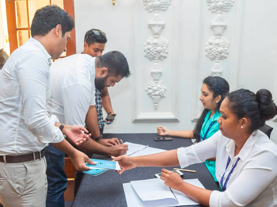 Woman handing over a membership document to a man